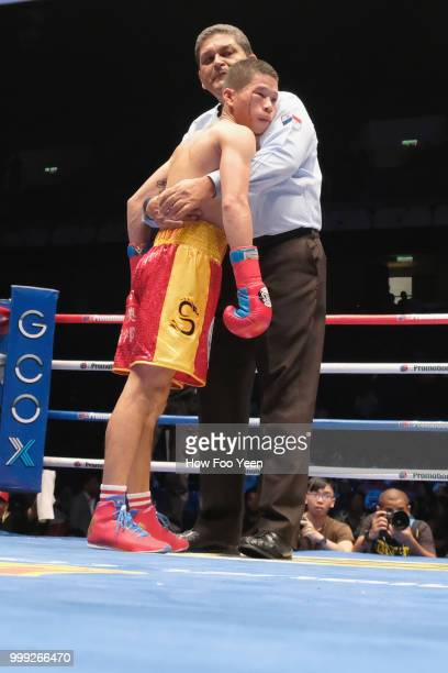 Refree holds on to Lu Bin of China after he declaress TKO on July 15 2018 in Kuala Lumpur Malaysia