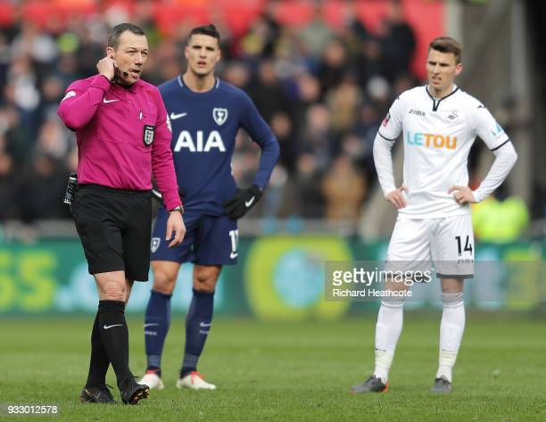 Refree Kevin Friend consults VAR before ruling HeungMin Son of Tottenham Hotspur's goal offside during The Emirates FA Cup Quarter Final match...