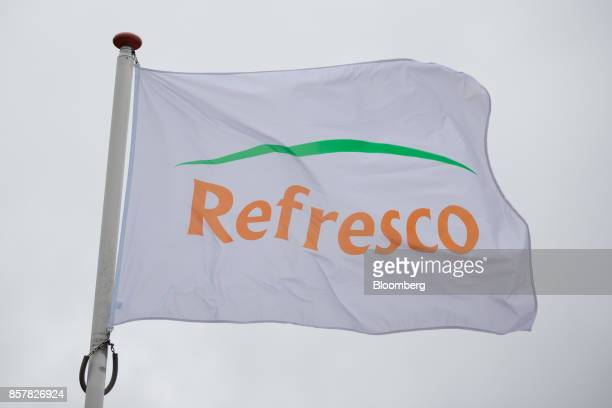 A Refresco Group NV logo sits on a flag outside the Refresco softdrink bottling factory in Maarheeze Netherlands on Thursday Oct 5 2017 Dutch...