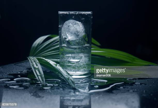 refresh glass high ball with ice cube with white background