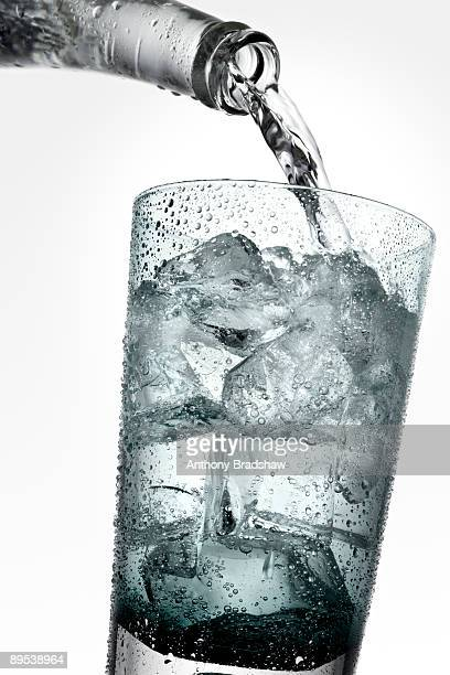 Refreshing drink being poured into a glass