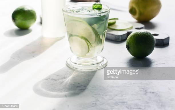 refreshing summer cold drink with shadow of glass - 冷たい飲み物 ストックフォトと画像