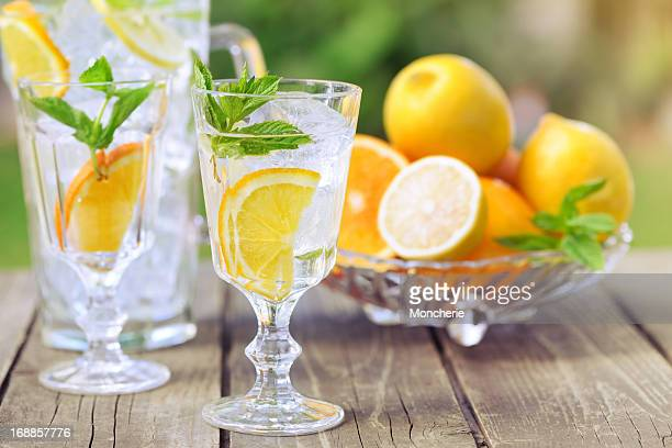 Refreshing water with ice and citrus fruit slices