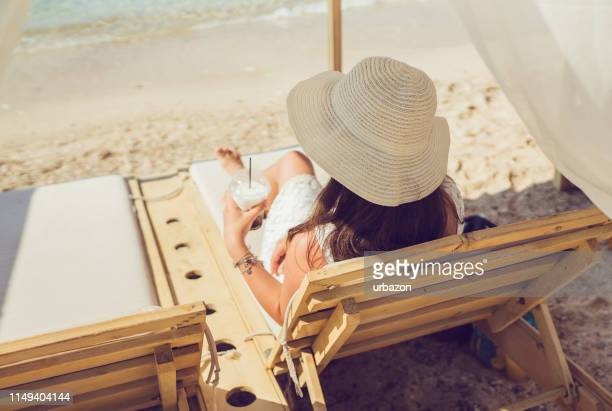 refreshment on the beach - shade stock pictures, royalty-free photos & images