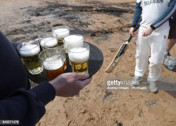 Refreshments are handed out during a match between the Ship Inn Cricket Club and the Eccentric Flamingoes Cricket Club on Sunday April 30th in front...