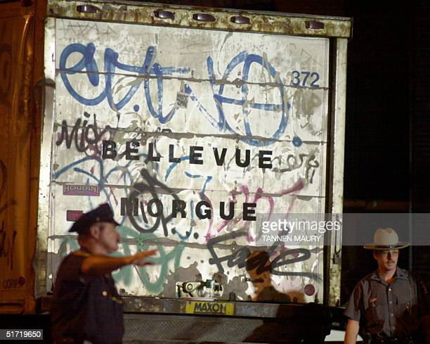 A refridgerated morgue trailer is backed up outside Bellevue Hospital 13 September 2001 in New York Rescue and cleanup continues after the World...