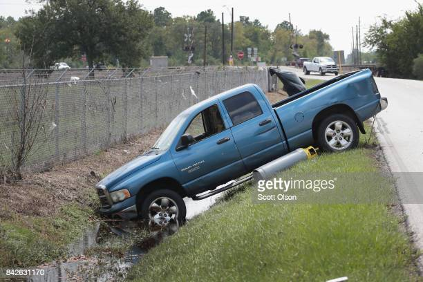A refrigerant gas cylinder rests next to a truck in a ditch outside of the Arkema plant which received major damage from flooding caused by Hurricane...