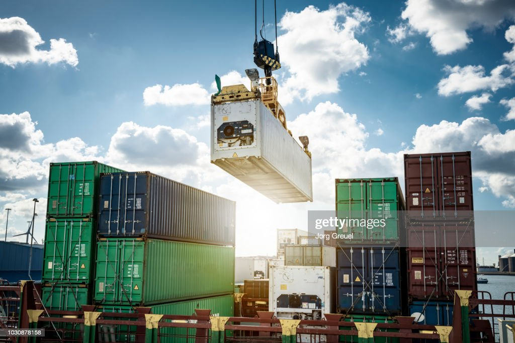 Refrigerated container being loaded on a container ship : Stock Photo