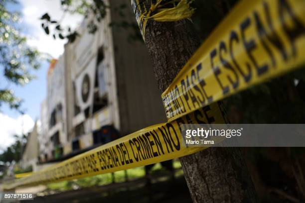 Refrigerated FEMA trailers which served as a morgue overflow following Hurricane Maria stand behind crime scene tape outside the Institute of...