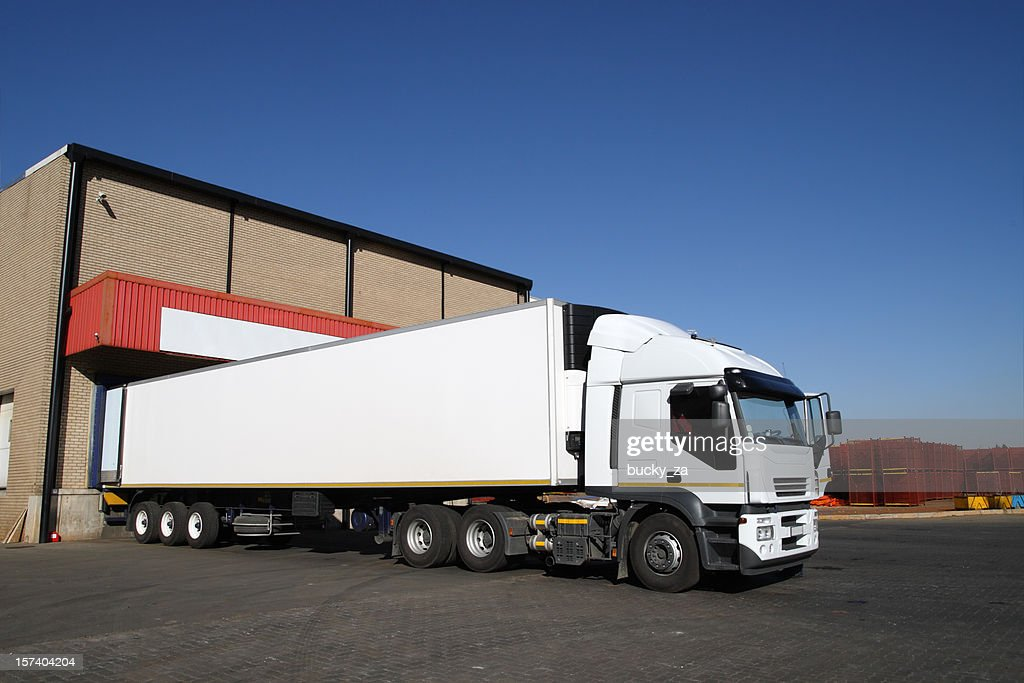 Refrigerated Semi Truck At A Cold Storage Warehouse Loading Bay