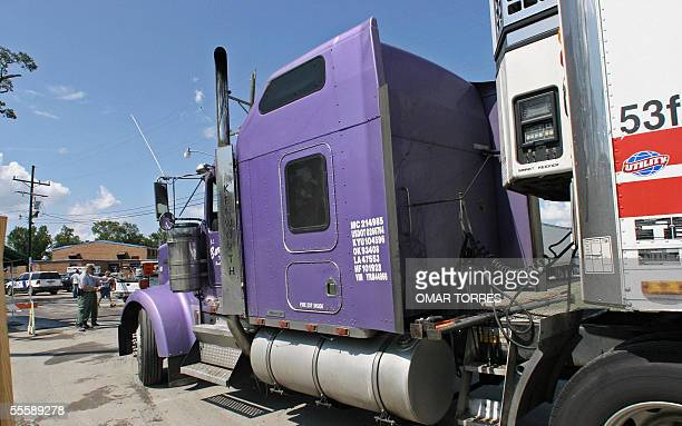 A refrigerated truck carrying the bodies of Hurricane Katrina victims arrives 15 September at the morgue installed in the Town Hall of St Gabriel...