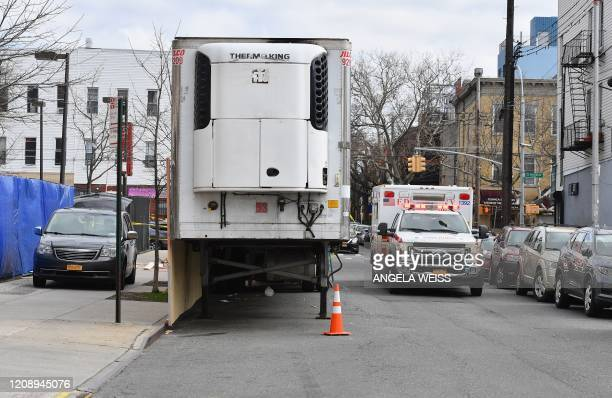 Refrigerated truck is parked at the Wyckoff Heights Medical Center in Brooklyn on April 2, 2020 in New York. - The Federal Emergency Management...