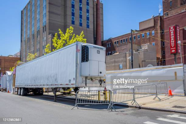 Refrigerated truck parked outside Wyckoff Hospital in Bushwick, serving as turn-based morgue in an attempt to alleviate funeral homes in Brooklyn...