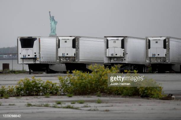 Refrigerated trucks functioning as temporary morgues are seen at the South Brooklyn Marine Terminal on May 06, 2020 in the Brooklyn borough of New...
