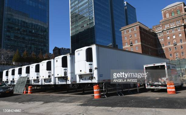 Refrigeration trucks are in place as workers build a makeshift morgue outside of Bellevue Hospital to handle an expected surge in Coronavirus victims...
