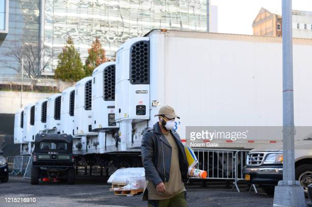 Refrigeration trucks are seen outside Bellevue Hospital's makeshift morgue on March 27 2020 in New York City The World Health Organization declared...
