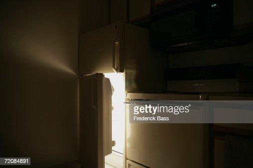 Refrigerator Door Open At Night Stock Photo Getty Images