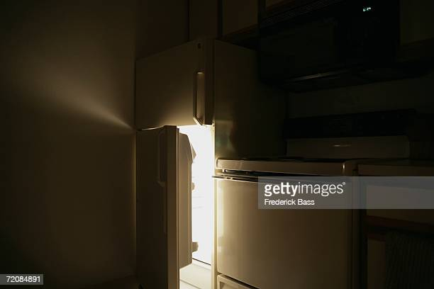 Refrigerator door open at night