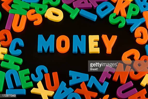 Refrigerator magnets spelling money
