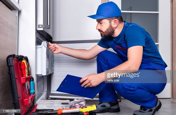 refrigerator repairing - appliance stock pictures, royalty-free photos & images