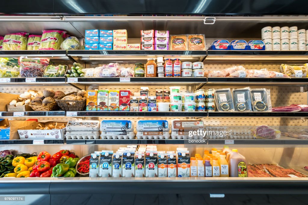 Refrigerator shelves in a grocery delicatessen store : Stock Photo