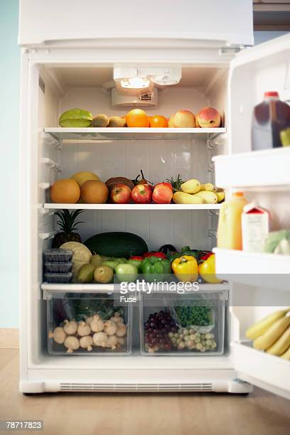 Refrigerator Stocked with Fruits and Vegetables