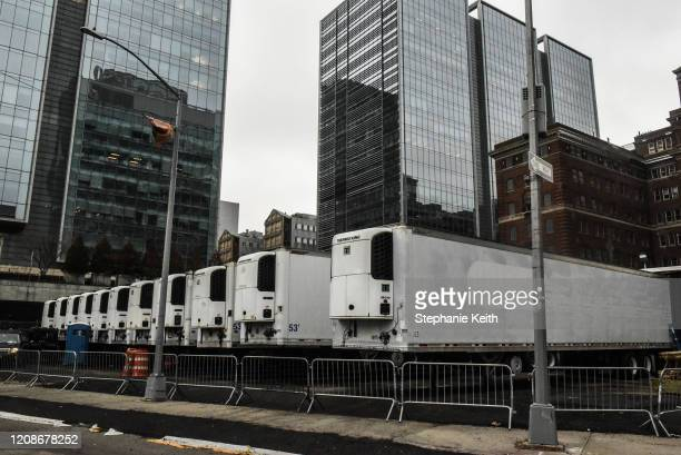 Refrigerator trucks are lined up behind NYU Langone Hospital on March 30 2020 in New York City Due to a surge in deaths caused by the Coronavirus...