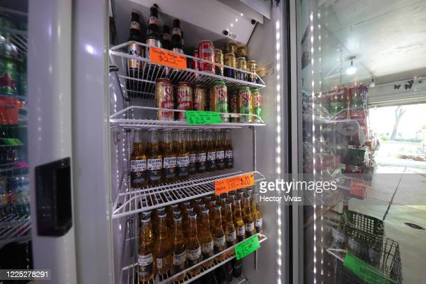 A refrigerator with Mexican beers is seen in a selfservice store that does have the authorization to sell on May 16 2020 in Mexico City Mexico...