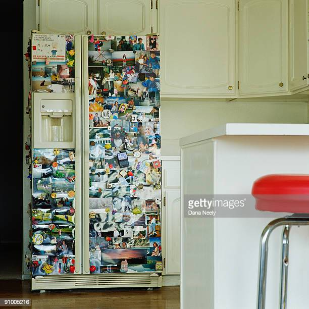 Refrigerator with photos and magnets