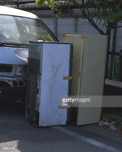 Refrigerators abandoned in front of truck