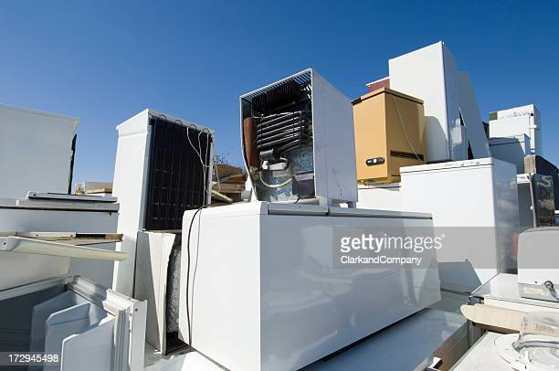 refrigerators piled up waiting to be recycled or scrapped. - obsolete stock pictures, royalty-free photos & images