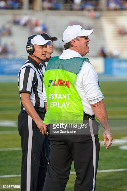 Refs under instant replay during the NCAA football game between the UTSA Roadrunners and the MTSU Blue Raiders on November 5 at Johnny Red Floyd...