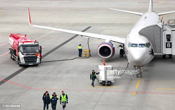 refueling aircraft from tanker vehicle - geographical locations stock pictures, royalty-free photos & images