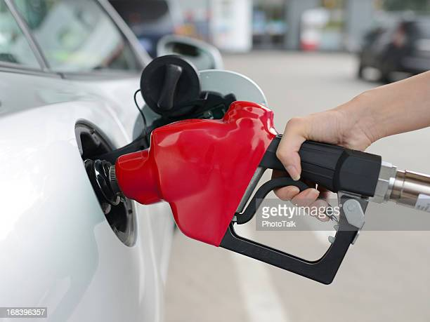 refueling at gas station - xxxxxlarge - gas tank stock photos and pictures