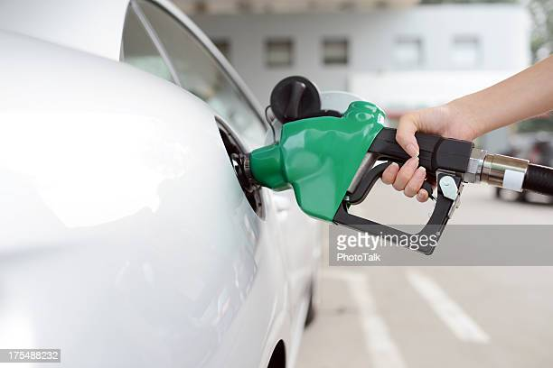 refueling at gas station - xxxxxlarge - storage tank stock photos and pictures
