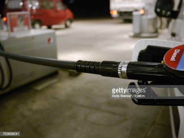 Refueling Pipe In Car At Gas Station