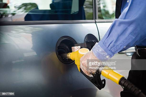 Refueling vehicle at gas station