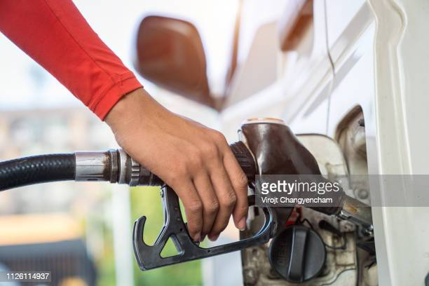 refueling vehicles, oil energy concept - fossil fuel stock pictures, royalty-free photos & images