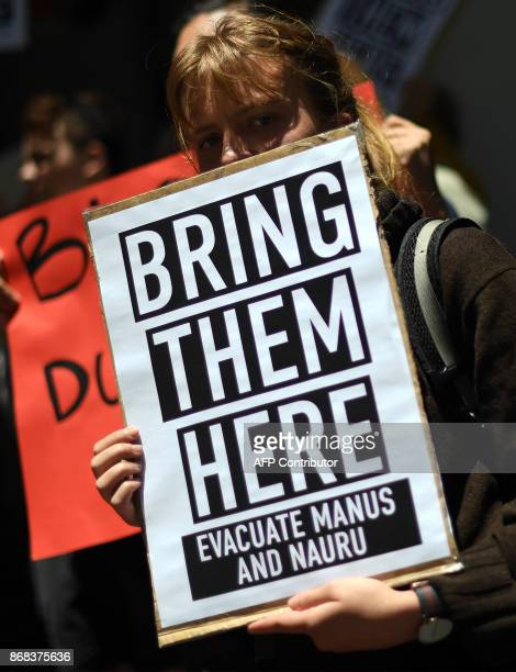 A refugee advocate protests against the closing of asylumseeker camps in Papua New Guinea in front of the Sydney Commonwealth government offices on...