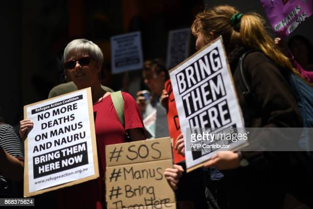 Refugee advocates protest against the closing of asylumseeker camps in Papua New Guinea in front of the Sydney Commonwealth government offices on...