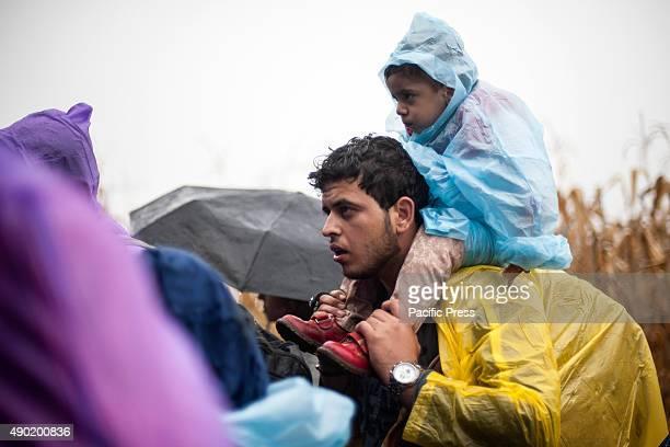 BORDER BAPSKA SYRMIA CROATIA Refugee and his child waiting to be able to cross the SerbianCroatian border