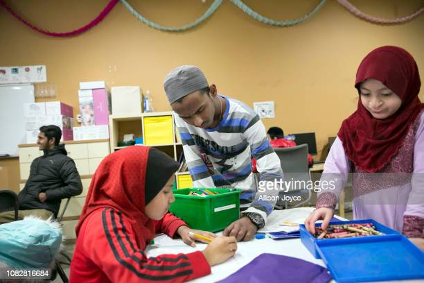 Refugee and soccer player Abdul Razor tutors children at the Rohingya Cultural Center of Chicago on January 10 2019 in Chicago Illinois Razor escaped...