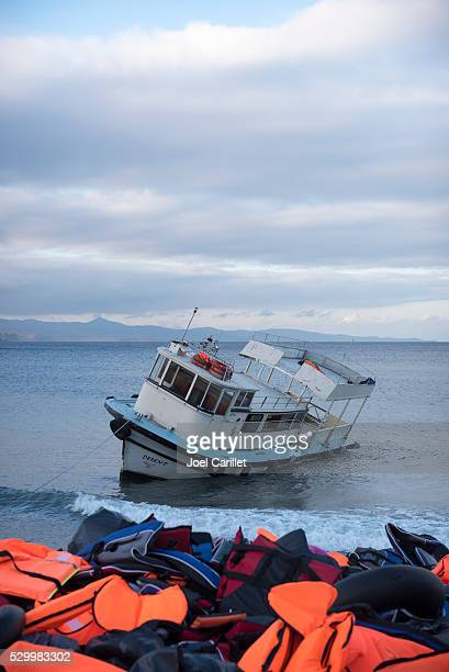 Refugee boat and lifejackets on Lesbos, Greece