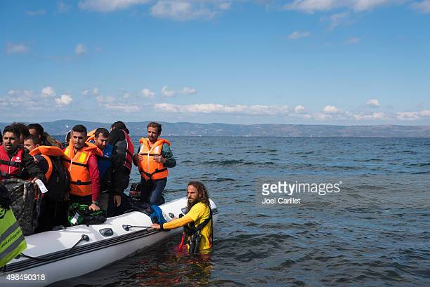 refugee boat arriving in europe - lesbos, greece - human trafficking stock photos and pictures