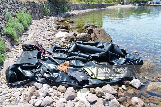 Refugee boat deflated on beach, Lesvos, Greece
