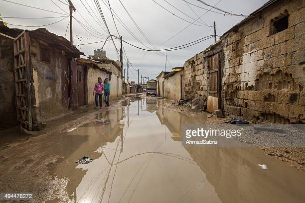 refugee camp flooded with rain water - refugee camp stock pictures, royalty-free photos & images