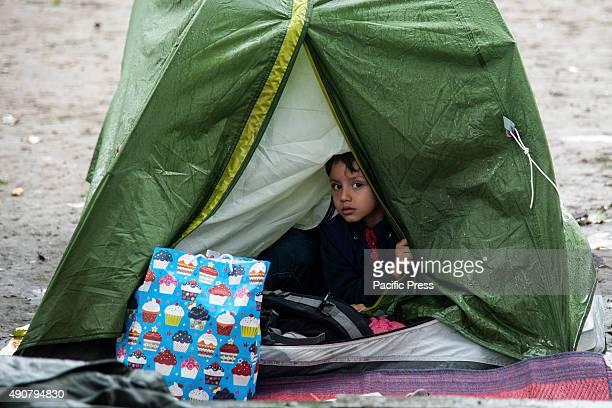 Refugee child inside a tent at the refugee camp of Belgrade in Park Luke elovia More and more refugees arrived at Belgrade camp despite of the rain...