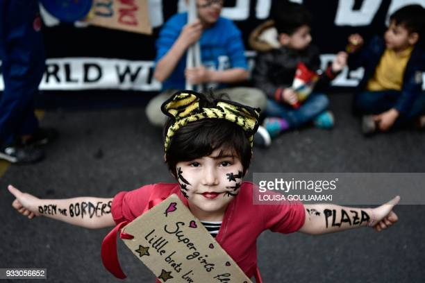TOPSHOT A refugee child participates in an antiracist demonstration in Athens on March 17 marking as well twoyears of the EUTurkey deal and the...