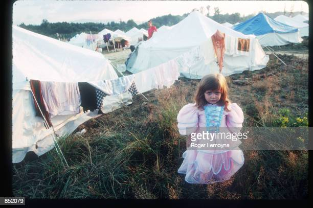 A refugee child stands in a UNICEF camp August 5 1995 near Kladanj Bosnia Herzogovina A number of camps were set up for displaced persons escaping...