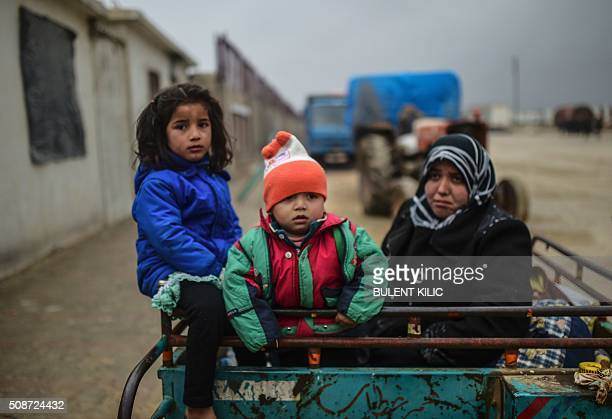 TOPSHOT Refugee children arrive a the Turkish border crossing gate as Syrians fleeing the northern embattled city of Aleppo wait on February 6 2016...